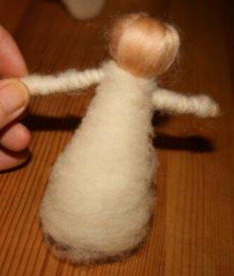 Bamboline in lana cardata 14